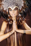 Fashion model in cleopatra style and feather Stock Images
