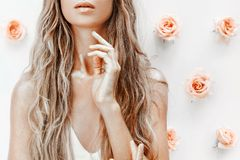 Fashion model close up portrait with roses and golden dust Stock Photos