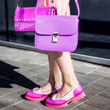 Fashion model with clutch in pink dress and shoes Royalty Free Stock Images