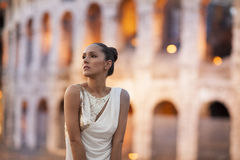 Fashion model with coloseum in the background. Rome, Italy Stock Images