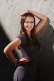 Fashion model by the concrete wall Stock Photography