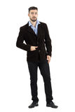 Fashion model in corduroy jacket looking at camera with hand in pocket Royalty Free Stock Photos