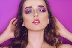 Fashion model with creative pink and blue make up.  Beauty art portrait of beautiful girl with colorful abstract makeup. Beautiful stock photography