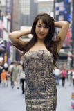 Fashion Model on Crowded City Street Royalty Free Stock Photography