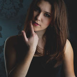 Fashion model on a dark background Stock Photography