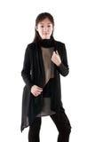 Fashion model in dark dress. Posing on white Royalty Free Stock Image