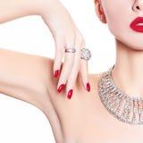 Fashion model demonstrates jewelry royalty free stock image