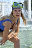 Fashion model demonstrates leotard and diving mask Royalty Free Stock Images