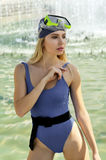 Fashion model demonstrates leotard and diving mask Stock Images