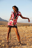 Fashion model in desert. Royalty Free Stock Image