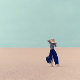 Fashion Model in the Desert on vacation Stock Image