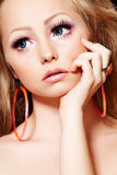 Fashion model with doll make-up, long eyelashes Stock Photography