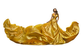 Fashion Model Dress, Woman Dance In Long Gown, Waving Golden Silk Fabric, Beautiful Girl On White Royalty Free Stock Image