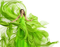 Fashion Model Dress, Woman in Flowing Fabric Gown, Clothes Flow. On Wind, Green over White background Royalty Free Stock Photo