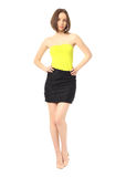 Fashion model dressed in short black skirt isolated on white Royalty Free Stock Images