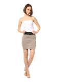 Fashion model dressed in short gray skirt isolated on white Stock Image