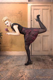 Fashion model in a dynamic pose Royalty Free Stock Photos