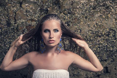 Fashion model with earrings Stock Photography