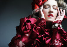 Fashion model in elegance red costume Stock Photography