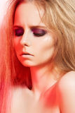 Fashion model with evening make-up and long hair Royalty Free Stock Images