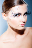 Fashion model with face art Stock Photography