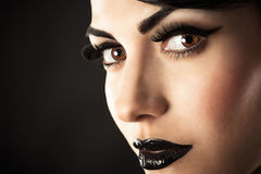 Fashion model face with black makeup royalty free stock photo