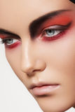 Fashion model face with devil halloween make-up royalty free stock image