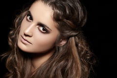 Fashion model face. Glamour make-up, shiny curly hair Royalty Free Stock Photography