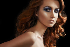 Fashion model face. Glamour make-up, shiny hair