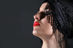 Fashion model face with red lip on black Stock Image