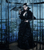Fashion model in fantasy dress. Posing in steel cage royalty free stock photos