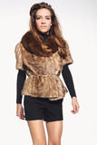 Fashion model in a fashionable vest with fur Royalty Free Stock Photography
