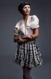 Fashion model female in retro clothes Royalty Free Stock Photo