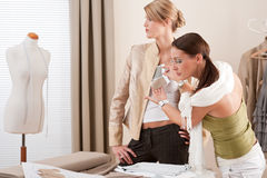 Fashion model fitting clothes by designer Stock Image