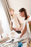 Fashion model fitting clothes by designer Royalty Free Stock Photo