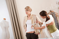 Fashion model fitting clothes by designer Royalty Free Stock Image