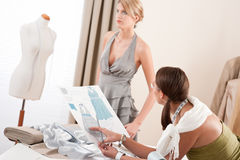 Fashion model fitting dress by designer Royalty Free Stock Photos