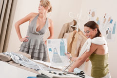 Fashion model fitting dress by designer Royalty Free Stock Photo