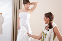 Fashion model fitting wedding dress by designer Stock Image
