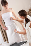 Fashion model fitting white dress by designer Stock Photography