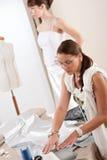 Fashion model fitting white dress by designer Stock Images