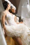 Fashion model fitting white wedding dress Royalty Free Stock Photos