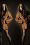 Fashion model in foxy jacket. Stock Images