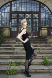 Fashion model in front of and old house. Fashion model with an black dress in front of and old house Royalty Free Stock Images
