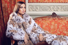 Fashion model in fur coat Royalty Free Stock Images