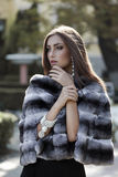 Fashion model in fur coat Royalty Free Stock Image