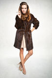 Fashion model in fur coat with cigarette Stock Photography