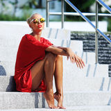 Fashion model girl. Beauty stylish blonde woman posing outdoor i royalty free stock image