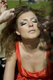 Fashion model girl doing makeup. Royalty Free Stock Image