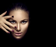 Fashion model girl face, beauty woman makeup and manicure. Over dark background Stock Photography